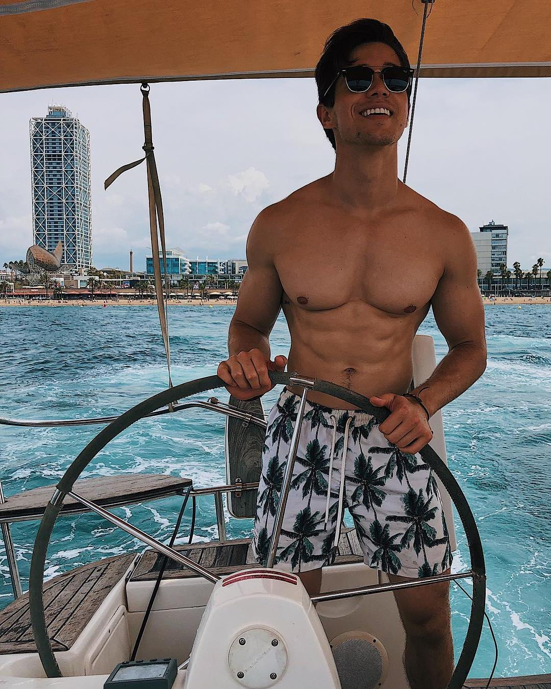 cute-bottom-gay-guys-smiling-fit-shirtless-summer-body-huge-pecs-vacation-boat-ride