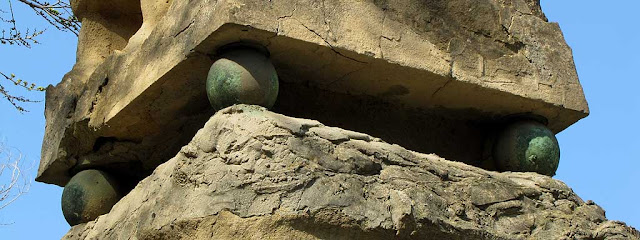 Bronze spheres of the obelisk in piazza Mazzini, Livorno