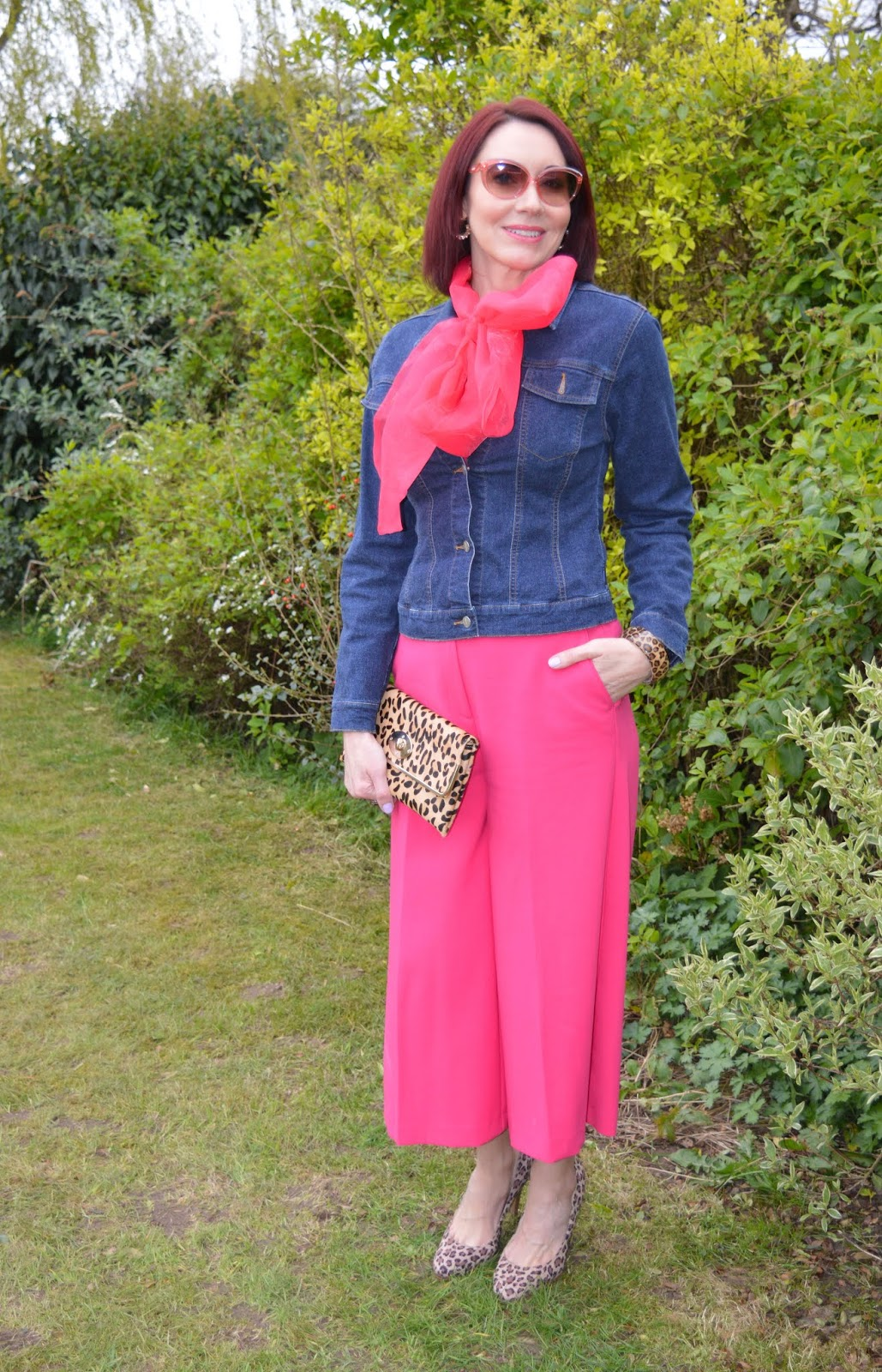 A denim jacket is given a new twist with fuchsia pink and leopard print accessories worn by over-40s style blogger Emma Peach