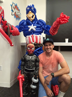 The Utah Balloon Artist next to Super Max with the life size Captain America behind them