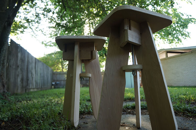 pair of flatpack stools in yard