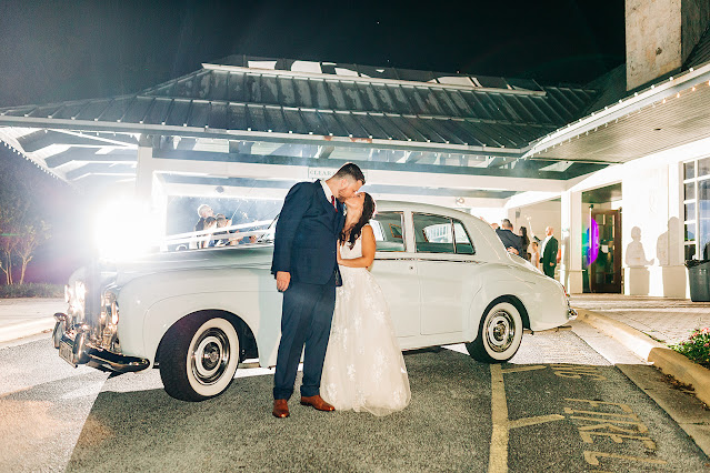 bride and groom wedding exit in classic car