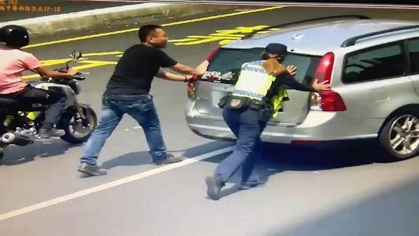 中秋連假車輛拋錨馬路中 彰化女警化身大力士急解危