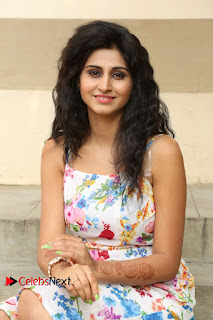Actress Shamili Stills in Floral Short Dress at Sree Ramaraksha Song Launch 0124
