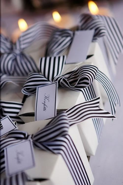Christmas gift wrapping - elegant black and white with striped ribbons