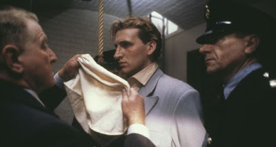 Executioner Albert Pierrepoint (Clive Revill) puts a bag over the head of Derek Bentley (Christopher Eccleston), in a scene from 'Let Him Have It', based on the real life case of Bentley, who was controversially hanged for murder in 1953.
