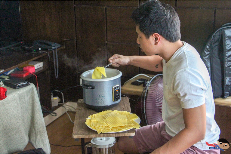 Alvin Francisco cooking the lasagna strips using a rice cooker