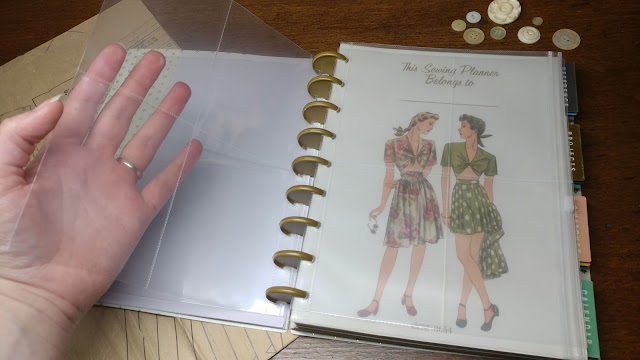 Clear pocket pages in a sewing planner