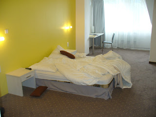 A Standard Room at the hotel Ostredok is large and done up in a neat colour scheme