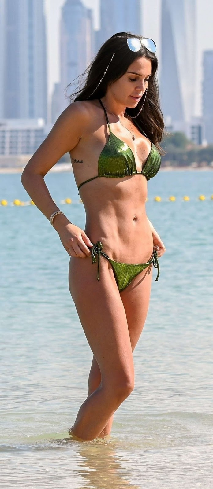 Danielle Lloyd displays results of boob job and bum lift on Dubai beach