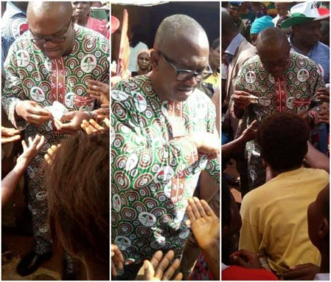 Former Governor Peter Obi spotted sharing money ahead of Anambra governorship election
