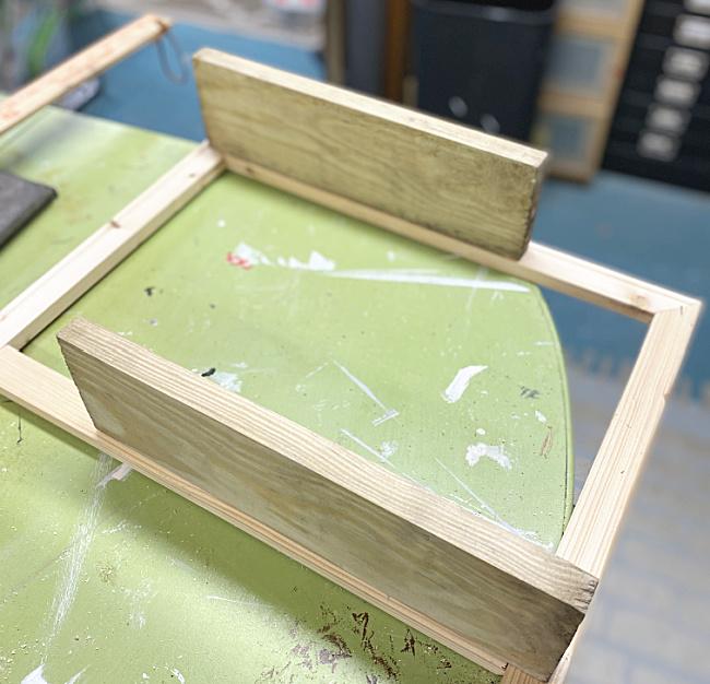 wooden shelves on window frame