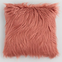 coral Mongolian faux fur throw pillow