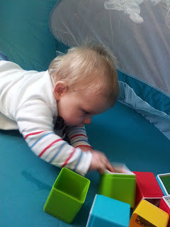 tummy time, baby building blocks, sensory toys, not crawling