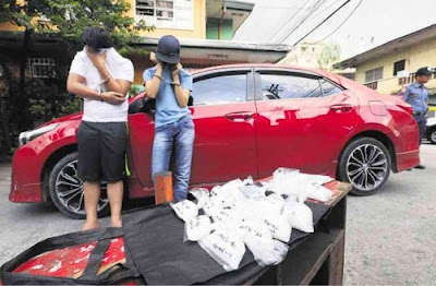"Drug pushers found carrying packs of ""shabu"" worth P4 million in their car by Quezon City Police, Philippines."