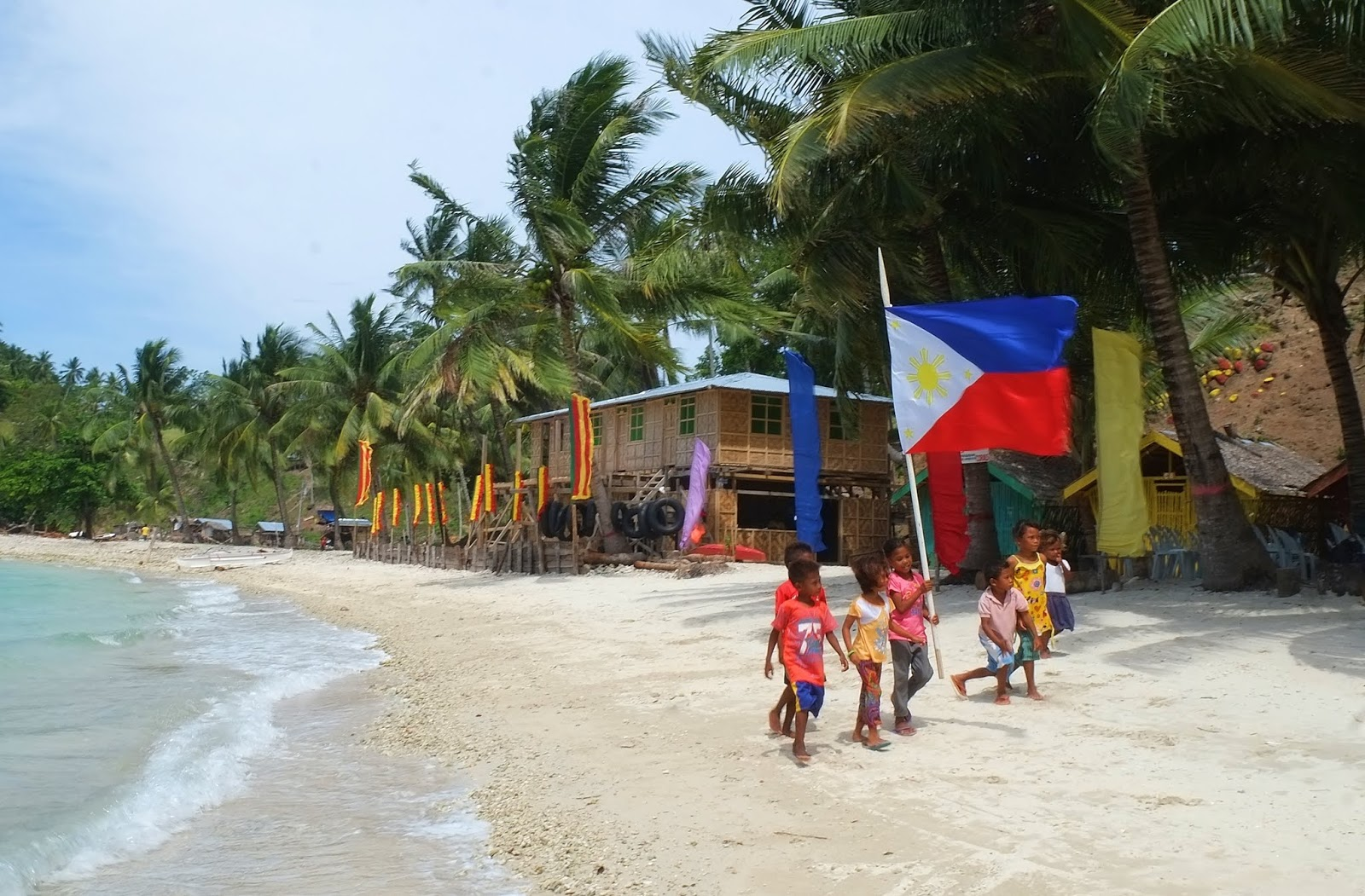 White Sand Beach and Proud Filipino Kids