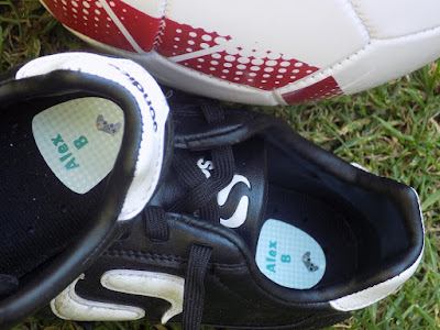 shoe labels stuck in football boots