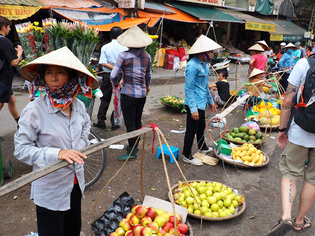Street vendors selling fruit in the Old Quarter of Hanoi, Vietnam