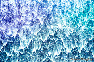 Cramer Imaging's professional quality fine art photograph of colored water and foam dripping in sheets in Idaho Falls, Bonneville, Idaho