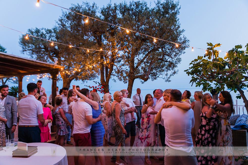 Wedding party underneath fairy lights