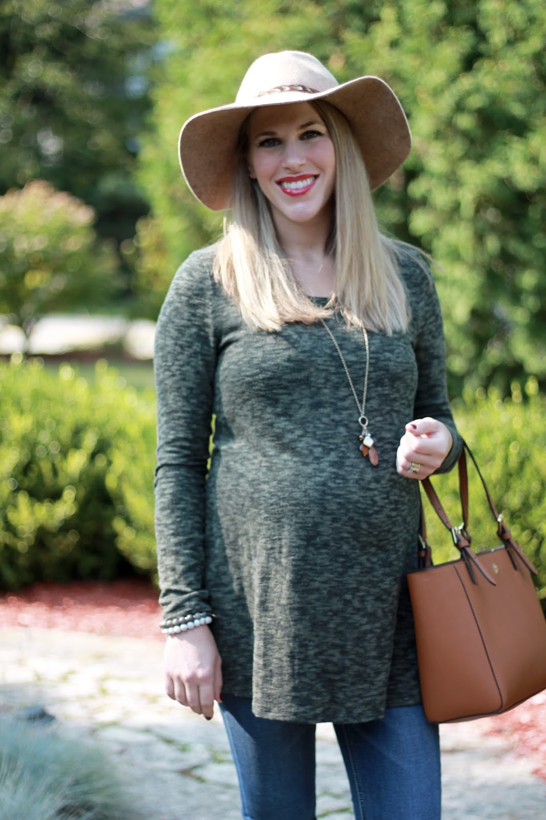 olive green maternity sweater, Jessica simpson maternity jeans, Steve Madden Harra booties, Tory Burch tote, wide brim hat, fall maternity outfit