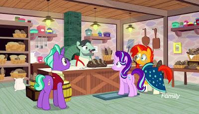 In the bakery, the baker shows off a blackened loaf to an unconvinced Starlight and Sunburst. Firelight looks on
