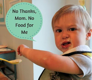 Baby saying no to food even though mom forces him by installing fear.