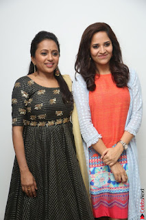Actress Suma in Black Salwar Suit and Anusuya in orange Dress at winner movie press meet part 1 February 2017 (48).JPG