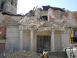 A wrecked local government building near the centre of L'Aquila