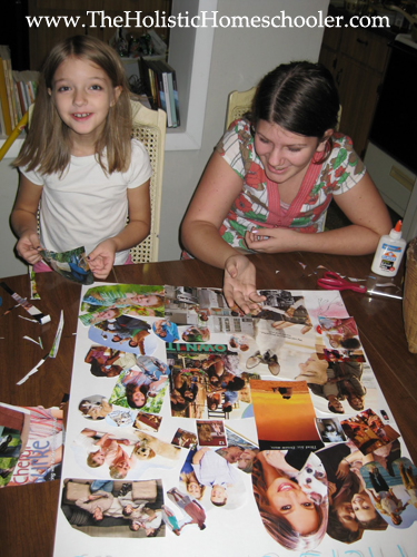 children attaching photos to poster board