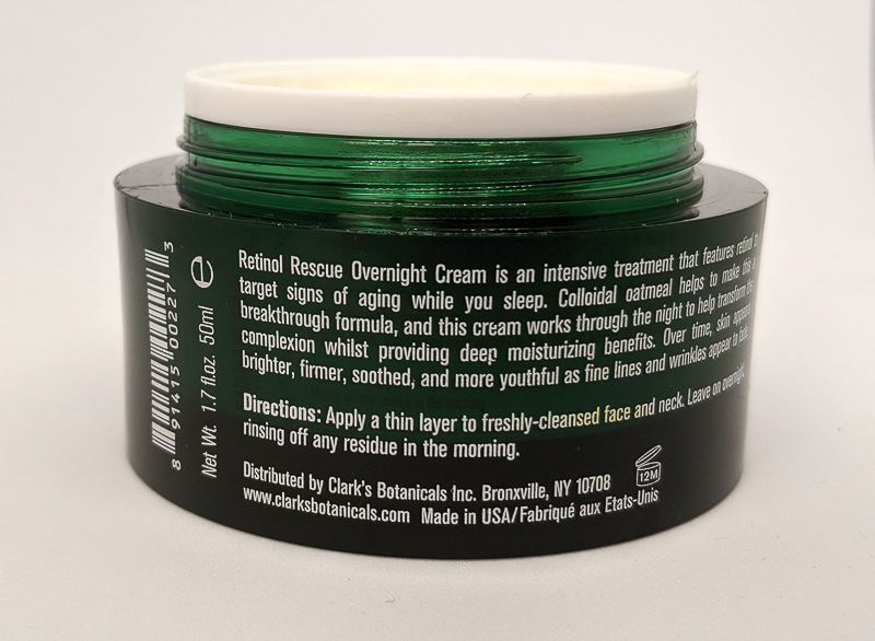 The back of a rar of Clark's Botanicals Retinol Rescue Overnight Cream. The jar is dark green with white writing