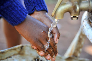 A bomet resident showers her hand on the water day. PHOTO | Courtesy