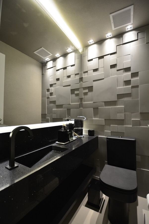 3D bathroom tile highlights the presence of the black sculpted tub