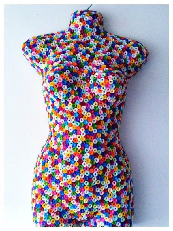 mannequin covered with tiny, colorful fringed paper flowers