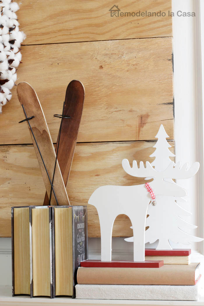 books, vintage ornament skis, wooden moose and tree decor