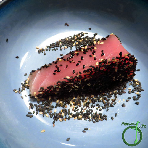 Morsels of Life - Sesame Crusted Tuna Step 3 - Press tuna steaks into sesame seeds to coat. Repeat for each side.