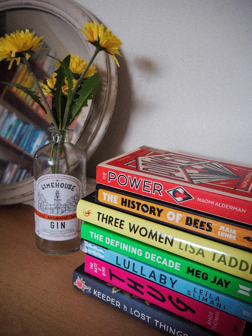 stack of books on desk