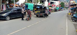 Cegah Gangguan Kamtibmas Dan Tindak Kriminal, Personil Polsek Alla Patroli Di Depan Pasar Sudu