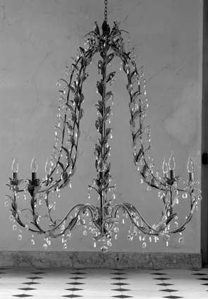 Wrought iron and crystal chandelier via Blanc d'Ivoire (fr) as seen on linenandlavender.net