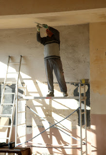 Scraping the ceiling of old paint