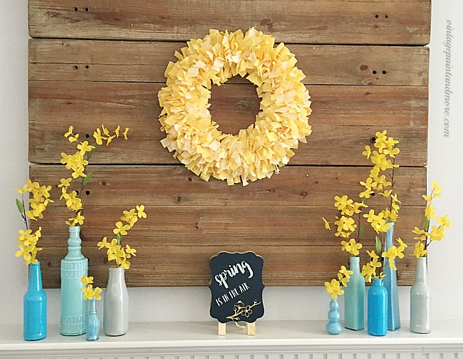 Vintage Paint and more... Spring mantel done with blue and yellow diy'd fabric rag wreath and recycled bottles