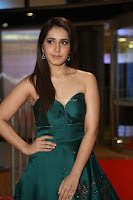 Raashi Khanna in Dark Green Sleeveless Strapless Deep neck Gown at 64th Jio Filmfare Awards South ~  Exclusive 090.JPG