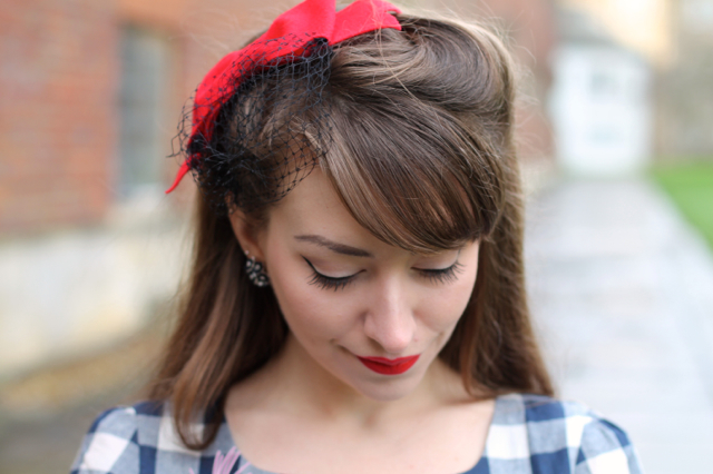 Alternate Normality bow fascinator with veil in red