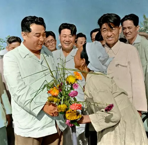Old woman giving Kim Il Sung flower bouquet, Joyang Agricultural Co-op, August 29, 1960