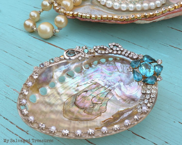 Abalone shells decorated with vintage jewelry