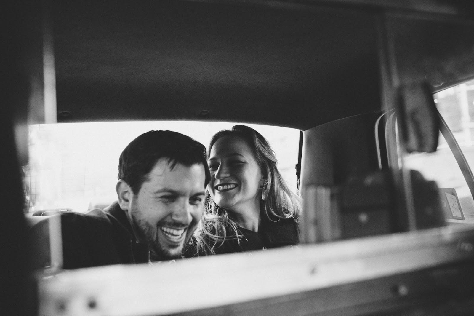 NYC Engagement Photos in the back of a taxi | Documentary wedding photography - blog.cassiecastellaw.com