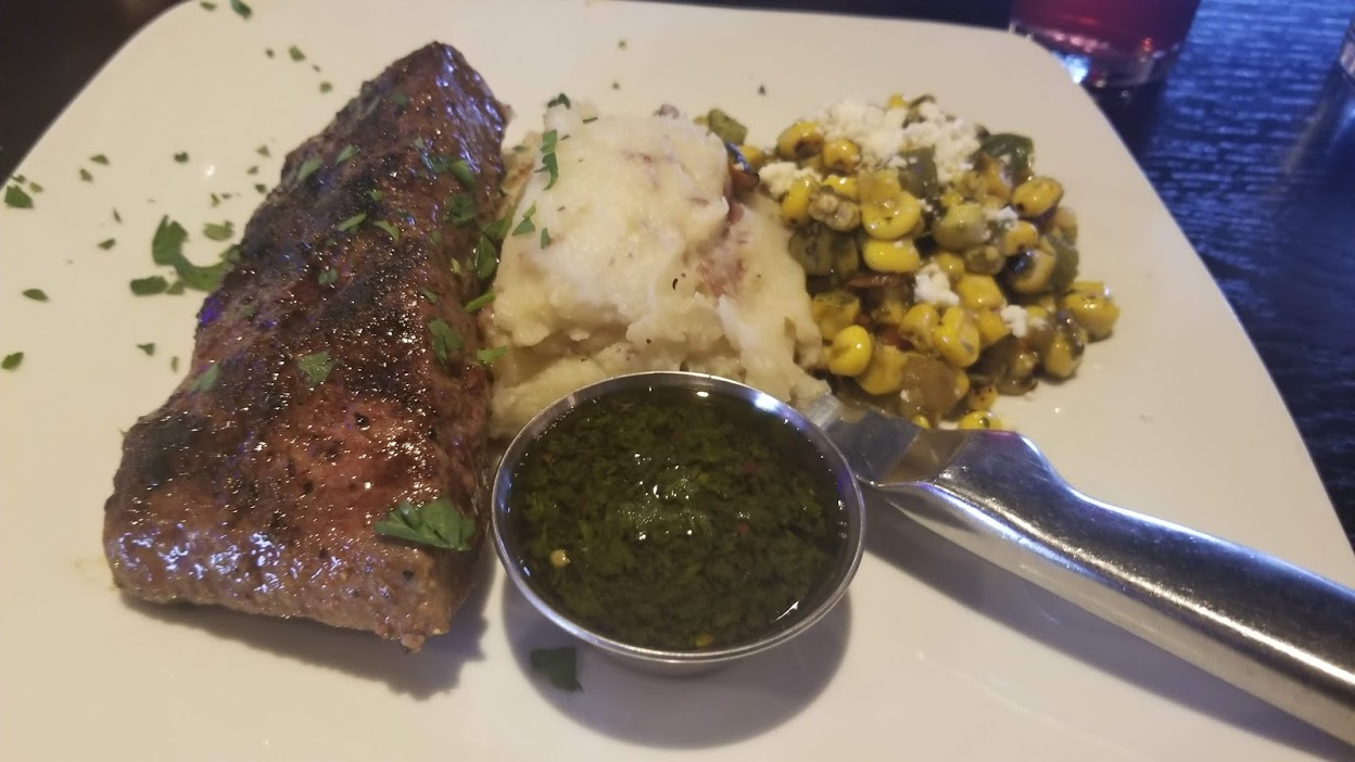 Flat iron steak with chimichurri sauce, mashed potatoes, & Mexican street corn, from Sedona Taphouse