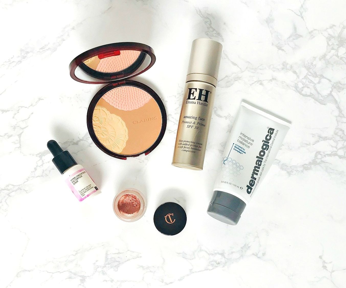 Dermalogica Intensive  Moisture Balance, Charlotte Tilbury Eyes to Mesmerise, Emma Hardie Amazing Face protect & Prime, Freshly Cosmetics Hyper Concentrate Eye Contour Serum, Clarins Bronzing Compact 001 Sunset Glow