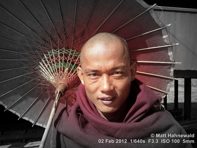 Burma, Myanmar, Inle Lake, friendly Burmese monk, Burmese man, people, street portrait, Buddhist monk, Burmese parasol, maroon robe, focal black and white