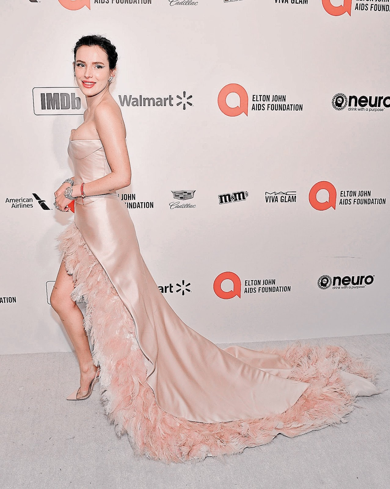 Bella Thorne shows off ample bosom at the Elton John AIDS Foundation 2020 Oscars Party
